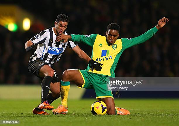 Hatem Ben Arfa of Newcastle United and Leroy Fer of Norwich City battle for the ball during the Barclays Premier League match between Norwich City...