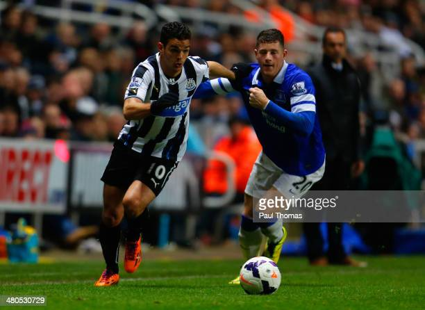 Hatem Ben Arfa of Newcastle United and Ross Barkley of Everton battle for the ball during the Barclays Premier League match between Newcastle United...