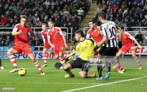 Hatem Ben Arfa of Newcastle United holds the attention of the Southampton defence during the Barclays Premier League match between Newcastle United...