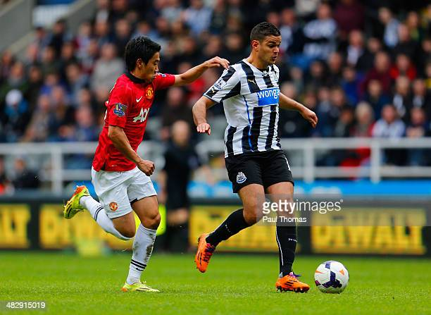 Hatem Ben Arfa of Newcastle United is closed down by Shinji Kagawa of Manchester United during the Barclays Premier League match between Newcastle...
