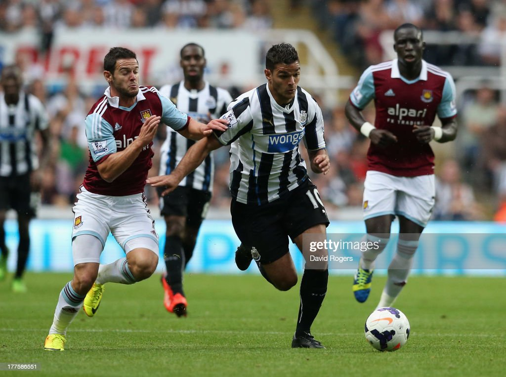 <a gi-track='captionPersonalityLinkClicked' href=/galleries/search?phrase=Hatem+Ben+Arfa&family=editorial&specificpeople=825038 ng-click='$event.stopPropagation()'>Hatem Ben Arfa</a> of Newcastle United moves away from Matthew Jarvis during the Barclays Premier League match between Newcastle United and West Ham United at St James' Park on August 24, 2013 in Newcastle upon Tyne, England.