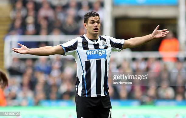 Hatem Ben Arfa of Newcastle United reacts during the Barclays Premier League game between Newcastle United and Liverpool at St James' Park on October...