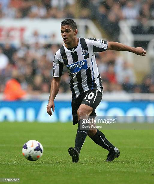 Hatem Ben Arfa of Newcastle United runs with the ball during the Barclays Premier League match between Newcastle United and West Ham United at St...