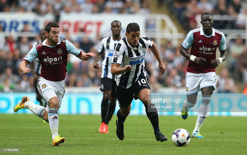 Hatem Ben Arfa of Newcastle United runs with the ball during the Barclays Premier League match between Newcastle United and West Ham United at St James' Park on August 24, 2013 in Newcastle upon Tyne, England.
