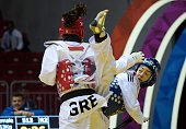 Hatice Yangn of Turkey competes with Andriana Asrogeraka of Greece during the women's 53 kg qualifying match within the WTF World Taekwondo...
