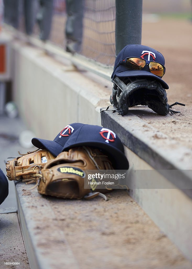 Hats and gloves belonging to the Minnesota Twins are seen on the dugout stairs during the game against the Detroit Tigers on April 3, 2013 at Target Field in Minneapolis, Minnesota.