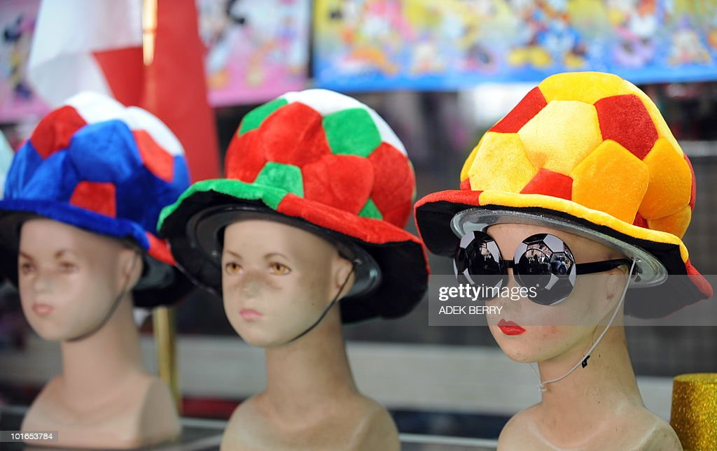 Hats and sunglasses shaped like footballs stand on display in a shop in Jakarta on June 6, 2010 for the 2010 World Cup football tournament in South Africa.