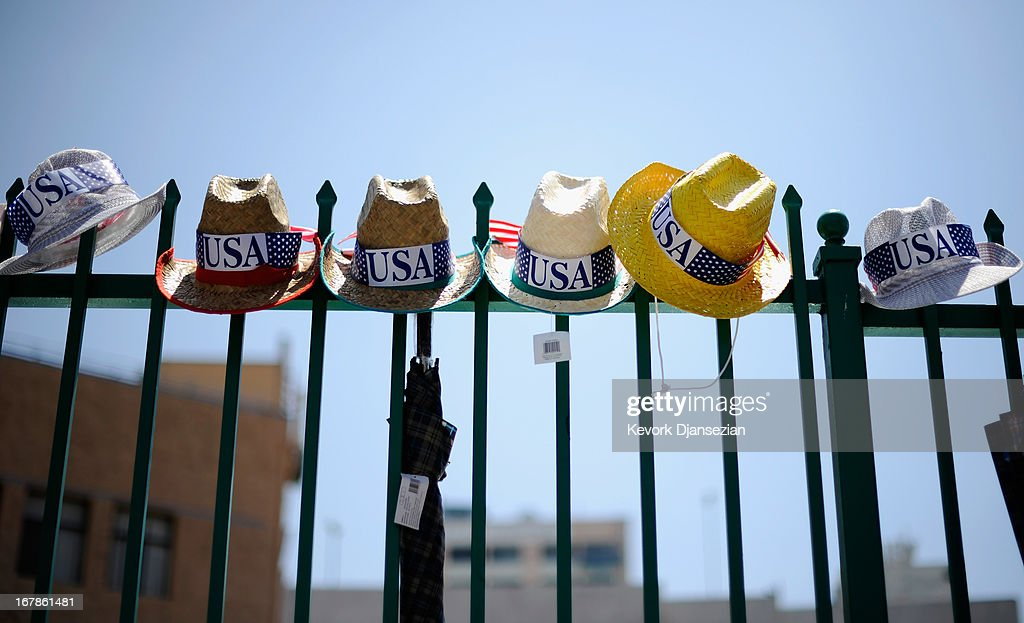 Hats are plcaed on an iron fence for sale during the May Day march and rally on May 1, 2013 in Los Angeles, United States. Labor organizations and immigration groups used the annual celebration to push for an immigration system overhaul.