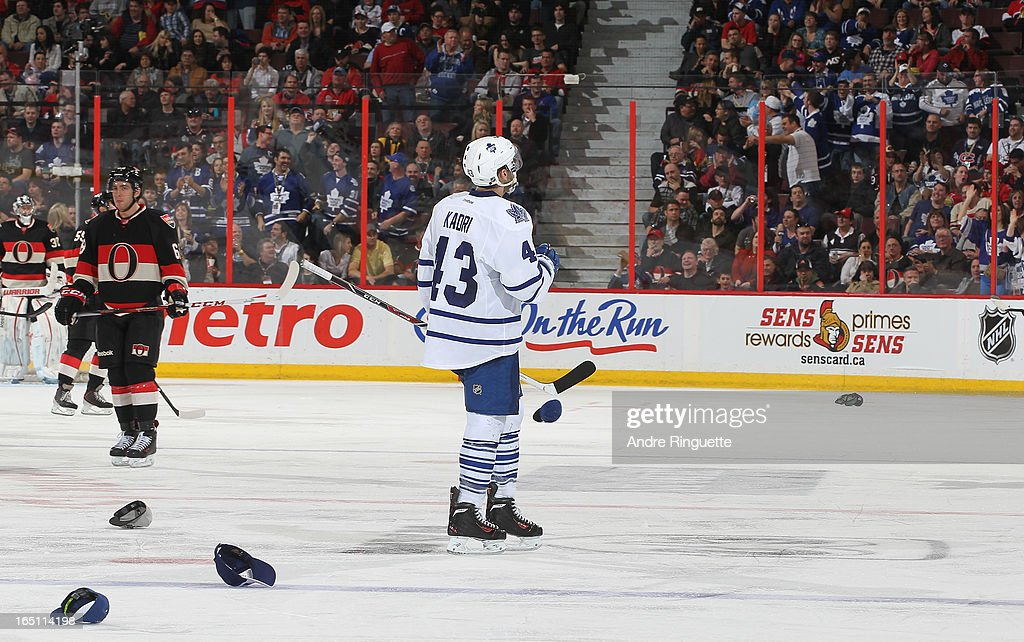 Hats lay on the ice as <a gi-track='captionPersonalityLinkClicked' href=/galleries/search?phrase=Nazem+Kadri&family=editorial&specificpeople=4043234 ng-click='$event.stopPropagation()'>Nazem Kadri</a> #43 of the Toronto Maple Leafs celebrates his hat trick goal against the Ottawa Senators on March 30, 2013 at Scotiabank Place in Ottawa, Ontario, Canada.