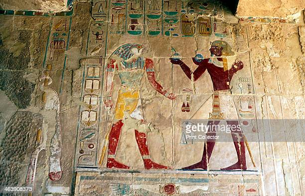 Hatshepsut Queen of Egypt presenting an offering to the falconheaded god Horus Hatshepsut is always shown as a male although she was a queen From the...