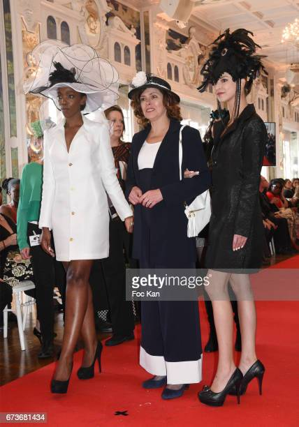 Hatter Marie Mirabelle Desnos and her models walk the runway during 'Fashion Night Couture 2017' Show at Salon des Miroirs on April 26 2017 in Paris...
