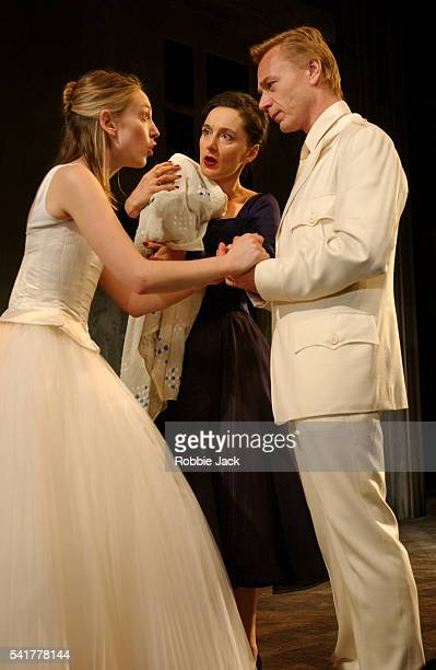 Hattie Morahan Kate Duchene and Ben Daniels in a production of Iphigenia at Aulis by Euripides translated by Don Taylor at the Royal National Theatre...