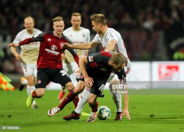 Hauke Wahl of FC Ingolstadt 04 and Hanno Behrens of 1FC Nuernberg battle for the ball during the Second Bundesliga match between 1 FC Nuernberg and...