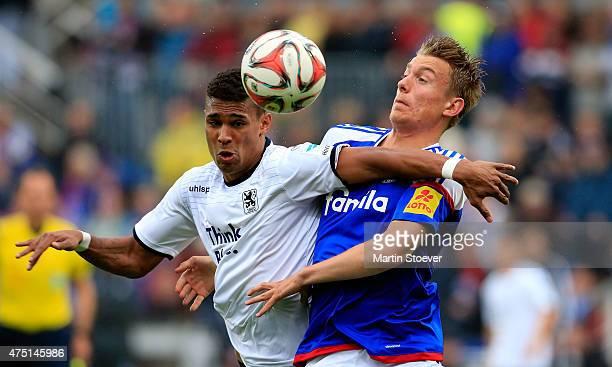 Hauke Wahl of Kiel challenges Rubin Okotie of Muenchen during the 2 Bundesliga Playoff First Leg between Holstein Kiel and 1860 Muenchen at Holsten...