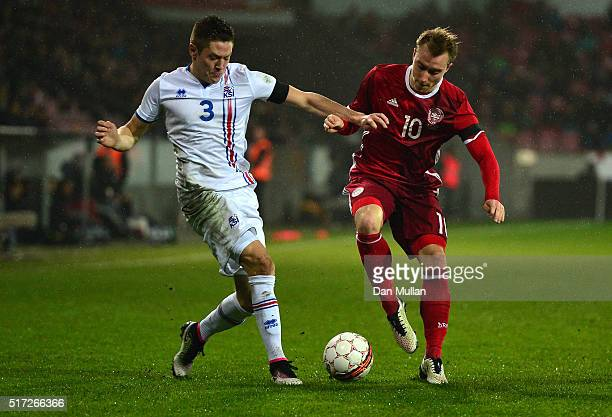 Haukur Heidar Hauksson of Iceland battles for the ball with Christian Eriksen of Denmark during the International Friendly match between Denmark and...