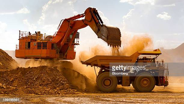 A haul truck is loaded by a digger with material from the pit at Rio Tinto Group's West Angelas iron ore mine in Pilbara Australia on Sunday Feb 19...
