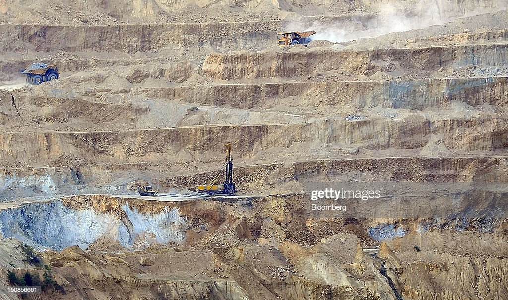 Haul trucks operate in the open cast mining pit at the copper mining and smelting complex, operated by RTB Bor Group, in Bor, Serbia, on Friday, Aug. 24, 2012. Copper neared a one-week low in London on signs Asian economies are slowing and speculation that U.S. policy makers will refrain from a fresh round of stimulus. Photographer: Oliver Bunic/Bloomberg via Getty Images
