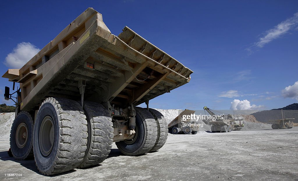 Haul trucks work at the Batu Hijau copper and gold mine operated by PT Newmont Nusa Tenggara in Sumbawa, West Nusa Tenggara province, Indonesia, on Wednesday, June 29, 2011. PT Newmont Nusa Tenggara is a unit of Newmont Mining Corp. Photographer: Dadang Tri/Bloomberg via Getty Images