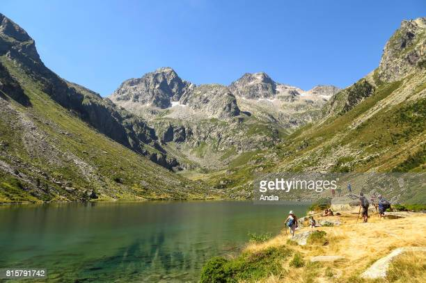 Hautes Pyrenees department Lake Estom and refuge viewed from the banks of the lake in the Lutour Valley above Cauterets In the background the two...