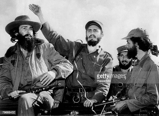 Havana Cuba 8th January 1959 Cuban communist leader Fidel Castro surrounded by his rebel guards receives a heros welcome from the cheering crowds as...