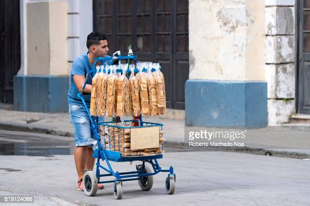 Havana economic changes self employment A man in blue pushes a small blue cart filled with long packs of biscuits for sale