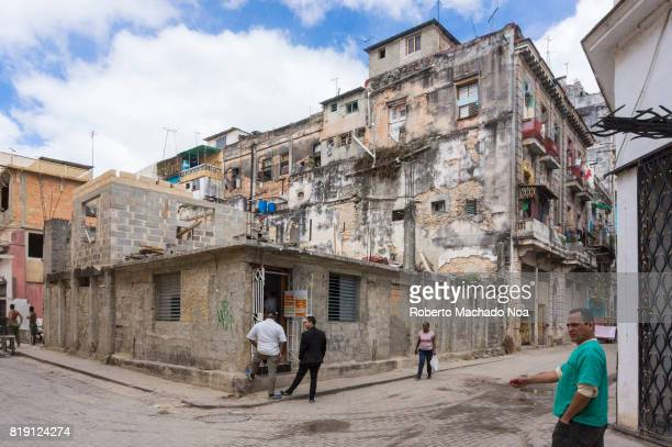 Havana non tourist district close to the Malecon The dilapidated and time worn corner buildings are a common sight in the Caribbean island