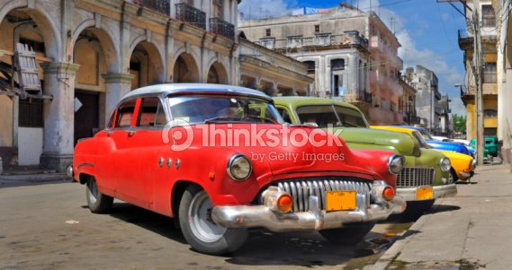 Havana street with colorful old cars in a row : Stock Photo