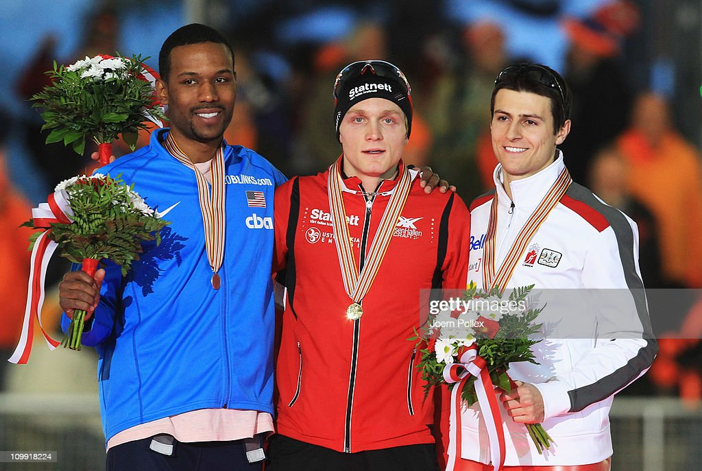 Havard Bokko of Norway for first place Shani Davis of USA for second place and Lucas Makowsky of Canada for third place take place on the podium...