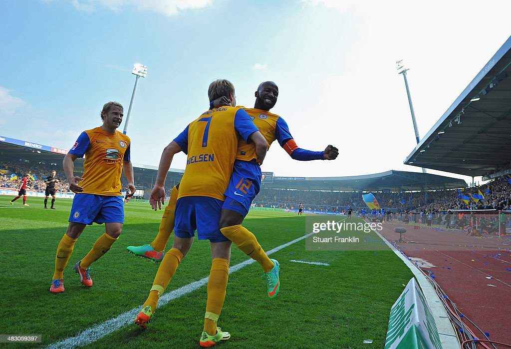 Havard Nielsen of Braunschweig celebrates scoring his goal with Domi Kumbela during the Bundesliga match between Eintracht Braunschweig and Hannover...