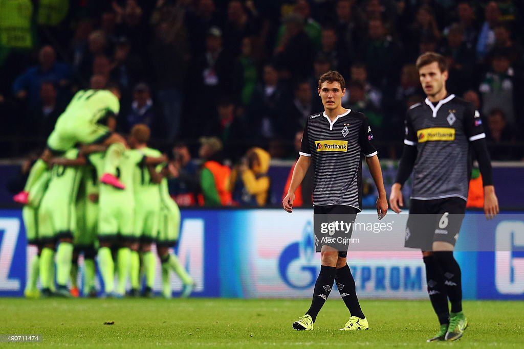 Havard Nordtveit (R) and Andreas Christensen of Moenchengladbach react as <a gi-track='captionPersonalityLinkClicked' href=/galleries/search?phrase=Sergio+Aguero&family=editorial&specificpeople=1100704 ng-click='$event.stopPropagation()'>Sergio Aguero</a> of Manchester is tackled for a penalty during the UEFA Champions League Group D match between VfL Borussia Monchengladbach and Manchester City at the Borussia Park Stadium on September 30, 2015 in Moenchengladbach, Germany.