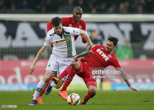 Havard Nordtveit of Borussia Moenchengladbach and Leonardo Jesus Bittencourt of Koeln compete for the ball during the Bundesliga match between...