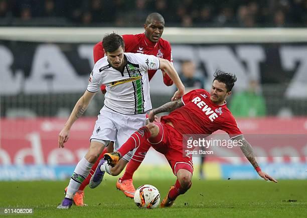 Havard Nordtveit of Borussia Moenchengladbach and Leonardo Jesus Bittencourt of Koeln compete for the ball during the Bundesliga match between...