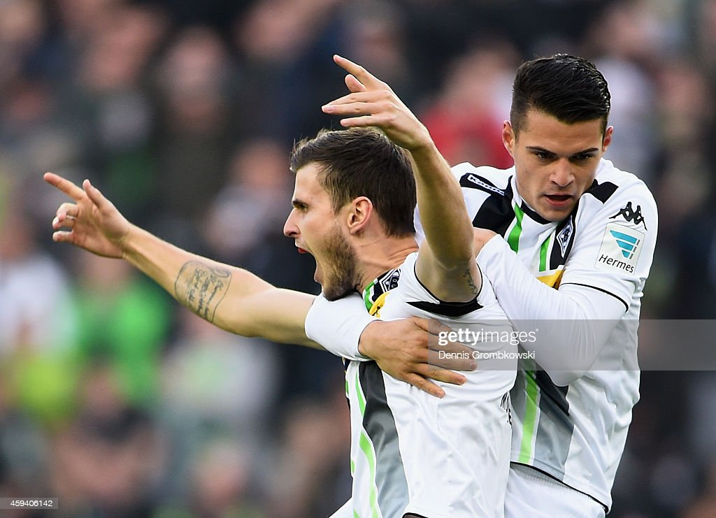 Havard Nordtveit of Borussia Moenchengladbach celebrates with team mate <a gi-track='captionPersonalityLinkClicked' href=/galleries/search?phrase=Granit+Xhaka&family=editorial&specificpeople=5848141 ng-click='$event.stopPropagation()'>Granit Xhaka</a> as he scores their first goal during the Bundesliga match between Borussia Moenchengladbach and Eintracht Frankfurt at Borussia Park Stadium on November 22, 2014 in Moenchengladbach, Germany.