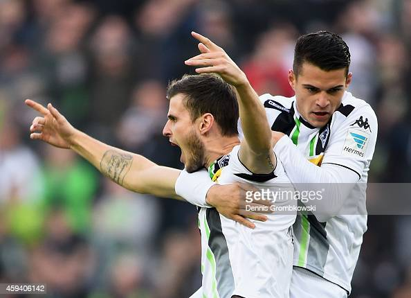 Havard Nordtveit of Borussia Moenchengladbach celebrates with team mate Granit Xhaka as he scores their first goal during the Bundesliga match...