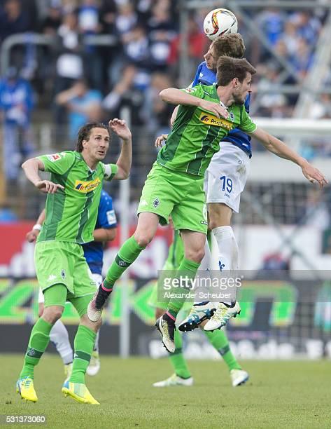 Havard Nordtveit of Borussia Moenchengladbach challenges Felix Platte of SV Darmstadt 98 during the first bundesliga match between SV Darmstadt 98...
