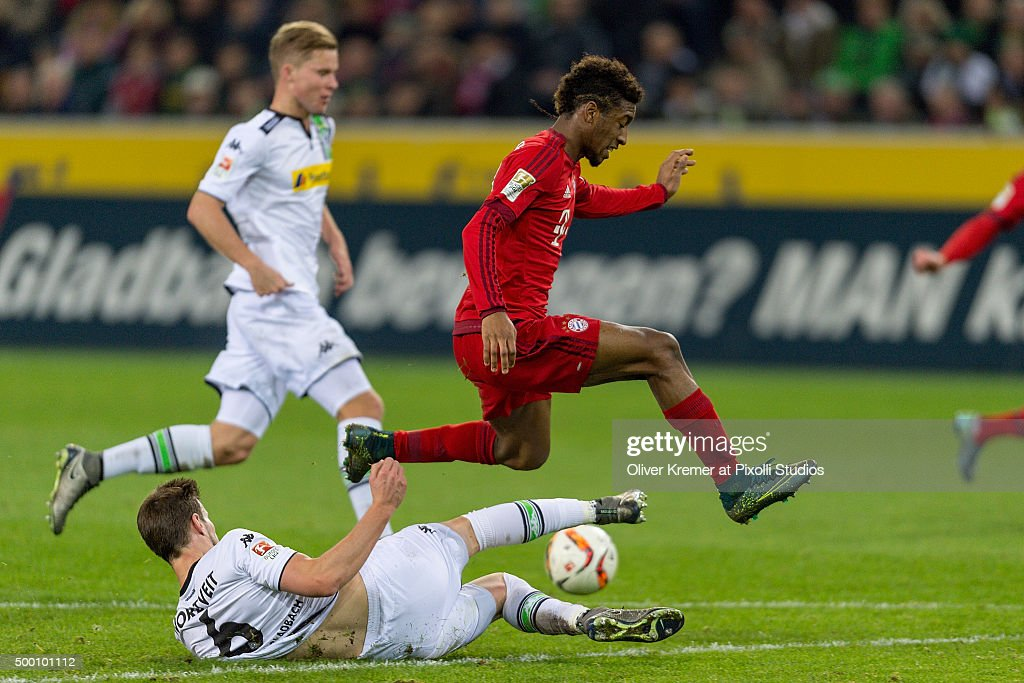 Havard Nordtveit (6) of Borussia Moenchengladbach defending the ball agains Midfielder <a gi-track='captionPersonalityLinkClicked' href=/galleries/search?phrase=Kingsley+Coman&family=editorial&specificpeople=10485667 ng-click='$event.stopPropagation()'>Kingsley Coman</a> (29) of Bayern Muenchen at Borussia-Park on December 05, 2015 in Moenchengladbach, Germany.