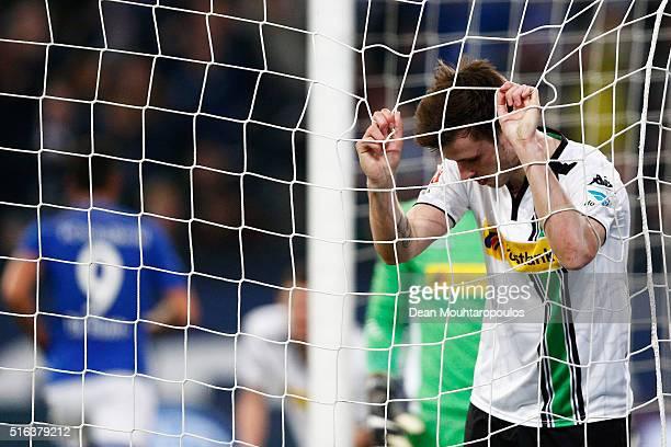 Havard Nordtveit of Borussia Monchengladbach looks dejected after team mate Martin Hinteregger scores and own goal during the Bundesliga match...