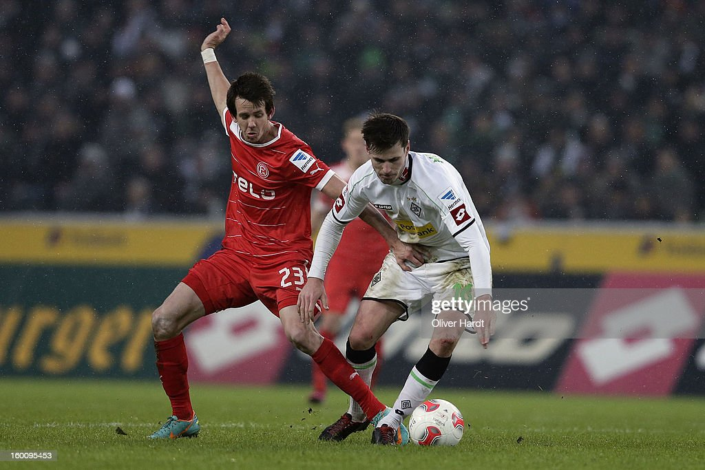 Havard Nordtveit (R) of Gladbach and Robbie Kruse (L) of Duesseldorf battle for the ball during at Bundesliga match between VfL Borussia Moenchengladbach v Fortuna Duesseldorf at Borussia Park Stadium on January 26, 2013 in Moenchengladbach, Germany.