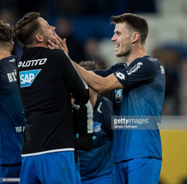 Havard Nordtveit of Hoffenheim celebrates winning with Mark Uth after the Bundesliga match between TSG 1899 Hoffenheim and FC Bayern Muenchen at...