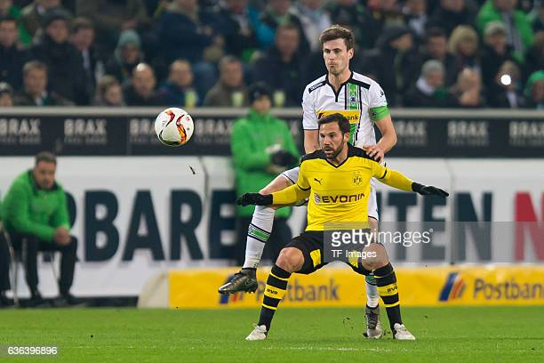 Havard Nordtveit of Moenchengladbach and Gonzalo Castro of Borussia Dortmund battle for the ball during the Bundesliga match between Borussia...