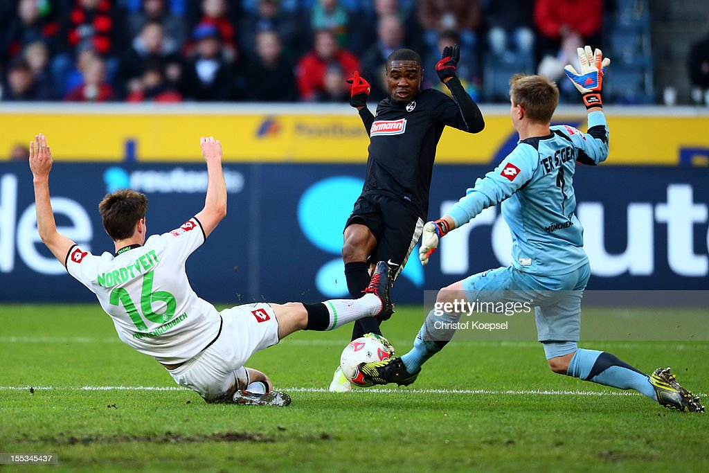 Havard Nordtveit of Moenchengladbach (L) and <a gi-track='captionPersonalityLinkClicked' href=/galleries/search?phrase=Marc-Andre+ter+Stegen&family=editorial&specificpeople=5528638 ng-click='$event.stopPropagation()'>Marc-Andre ter Stegen</a> (R) challenge Cedric Makiadi of Freiburg (C) during the Bundesliga match between VfL Borussia Moenchengladbach and SC Freiburg at Borussia Park Stadium on November, 2012 in Moenchengladbach, Germany.