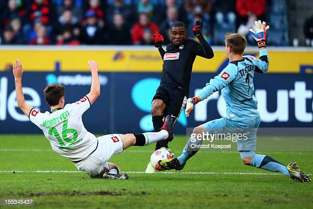 Havard Nordtveit of Moenchengladbach and MarcAndre ter Stegen challenge Cedric Makiadi of Freiburg during the Bundesliga match between VfL Borussia...