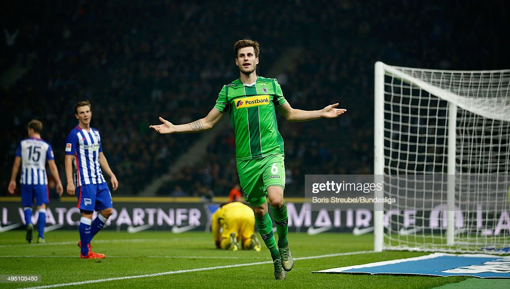 Havard Nordtveit (R) of Moenchengladbach celebrates after scoring his team's fourth goal during the Bundesliga match between Hertha BSC and Borussia Moenchengladbach at Olympiastadion on October 31, 2015 in Berlin, Germany.