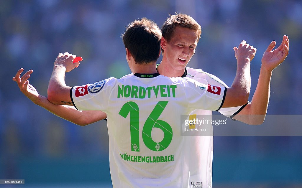 Havard Nordtveit of Moenchengladbach celebrates with team mate Luuk de Jong after scoring his teams second goal during the first round match of the DFB Cup between Alemannia Aachen and Borussia Moenchengladbach at Tivoli Stadium on August 18, 2012 in Aachen, Germany.