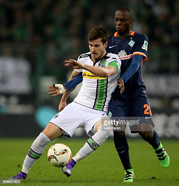 Havard Nordtveit of Moenchengladbach is challenged by Anthony Ujah of Bremen during the Bundesliga match between Borussia Moenchengladbach and Werder...