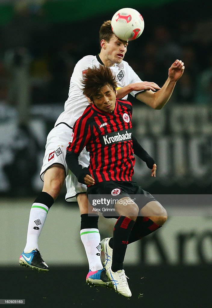 Havard Nordtveit of Moenchengladbach outjumps <a gi-track='captionPersonalityLinkClicked' href=/galleries/search?phrase=Takashi+Inui&family=editorial&specificpeople=7174976 ng-click='$event.stopPropagation()'>Takashi Inui</a> of Frankfurt during the Bundesliga match between Eintracht Frankfurt and Borussia Moenchengladbach at Commerzbank-Arena on March 1, 2013 in Frankfurt am Main, Germany.