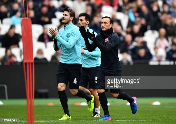 Havard Nordtveit of West Ham United and Mark Noble of West Ham United applaud the fans during a West Ham United family fun day at London Stadium on...