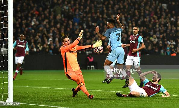 Havard Nordtveit of West Ham United scores an own goal which after he is put under pressure from Raheem Sterling of Manchester City during The...