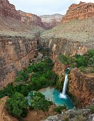 Waterfall in the Grand Canyon with blue water