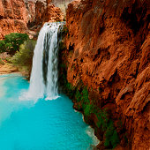 Mineral-filled water descends from red rock Havasu Falls in Northern Arizona.